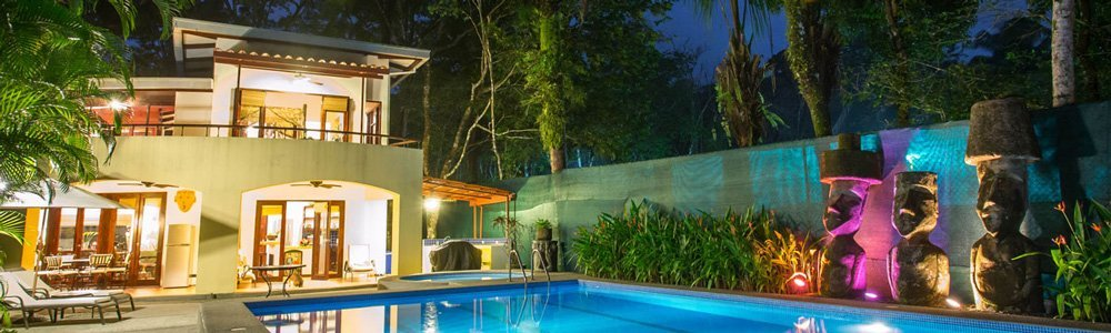 Discovery-Beach-House-pool-at-night-header
