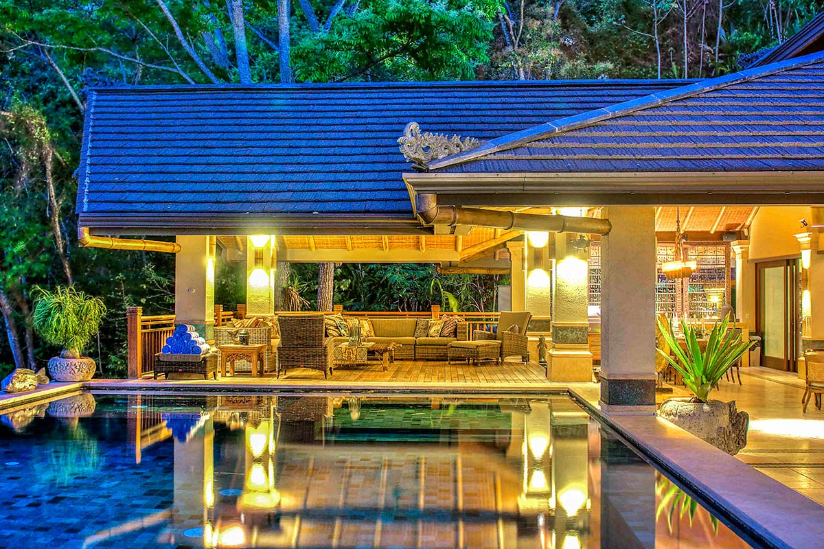 House, deck, and pool at night